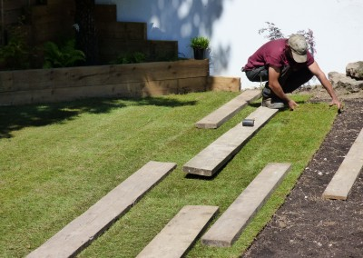 New turff lawn being laid by Trees & Garden Services in Brighton